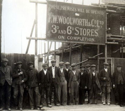 The Woolworths construction workers pose for the camera on the site of a new standard-model store in the 1930s